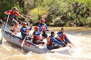 Group whitewater rafting.