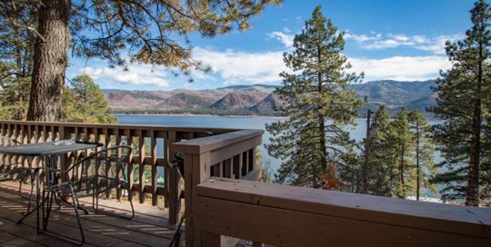 Cabin patio and view of lake.