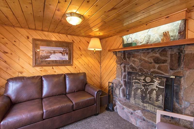 Cabin 15 living room with fireplace.